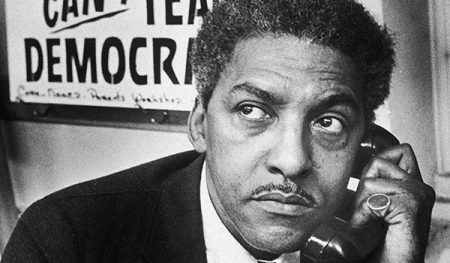 2nd February 1964: Civil Rights activist Bayard Rustin, spokesman for the Citywide Committee for Integration, talks on the phone at the organization's headquarters at Silcam Presbyterian Church, Brooklyn, New York. (Photo by Patrick A. Burns/New York Times Co./Getty Images)